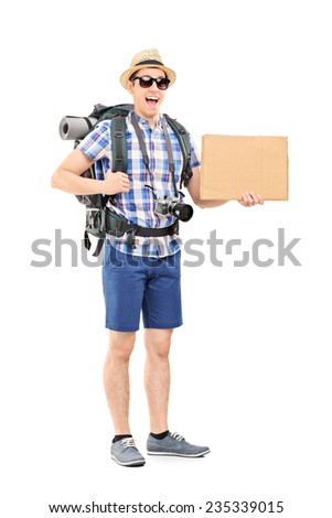 Full length portrait of an excited tourist holding a blank cardboard sign isolated on white background - stock photo
