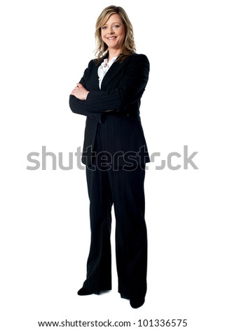 Full length portrait of an experienced business woman standing with arms folded - stock photo