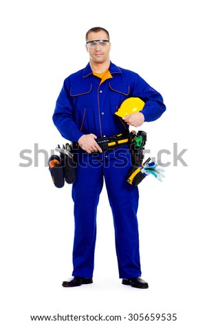 Full length portrait of an industrial worker wearing uniform and tools. Job, occupation. Isolated over white.  - stock photo