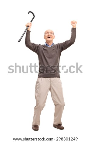 Full length portrait of an overjoyed senior holding a black cane an looking up isolated on white background - stock photo