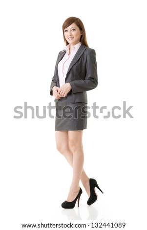 Full length portrait of Asian business woman wear skirt suit, isolated on white background.