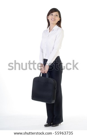 Full length portrait of Asian business woman with briefcase standing on white background. - stock photo