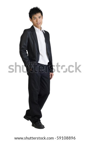 Full length portrait of Asian young business man standing against white. - stock photo