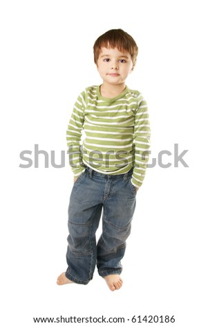 Full length portrait of asmiling little boy in jeans on white background - stock photo