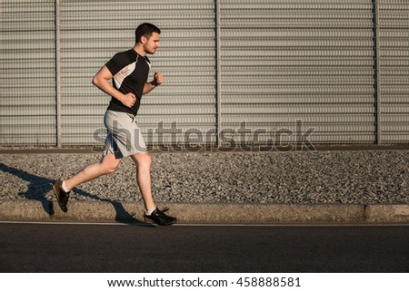 Full length portrait of athletic man running - stock photo