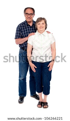 Full length portrait of attractive aged couple isolated over white background - stock photo