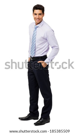Full length portrait of attractive businessman with hands in pockets standing over white background. Vertical shot.