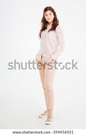 Full length portrait of attractive charming female standing over white background - stock photo