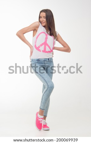 Full length portrait of attractive smiling teenage girl isolated on white background, concept of happy student, youth, confidence. - stock photo