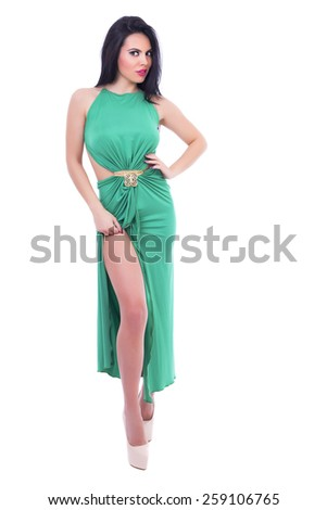 Full length portrait of beautiful brunette woman posing over white background - stock photo