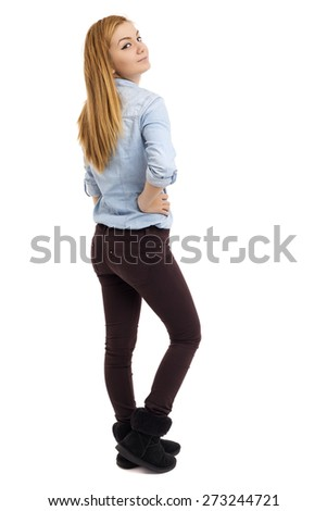 Full length portrait of beautiful caucasian teenage girl  looking over her shoulder isolated on white background
