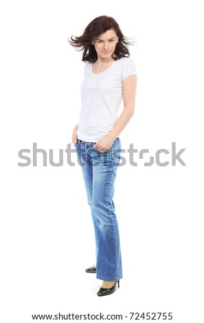 Full-length portrait of beautiful girl in jeans and white t-shirt - stock photo