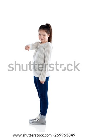Full length portrait of beautiful little girl pointing at camera on white background - stock photo