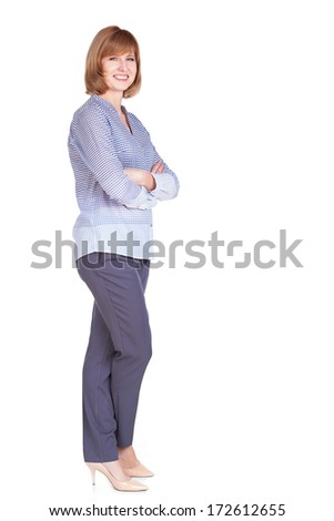Full length portrait of beautiful mature woman standing isolated over white background - stock photo