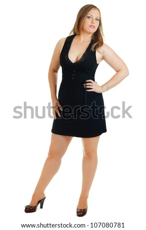 full-length portrait of beautiful plus size young blond woman posing on white in black dress and court shoes - stock photo