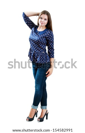 full-length portrait of beautiful plus size young brunette woman posing on white in blue jeans and court shoes  - stock photo