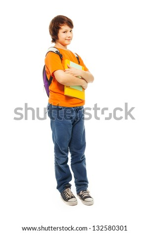 Full length portrait of beautiful teenage boy with pile of books and backpack on white - stock photo