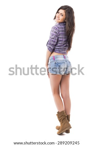 Full length portrait of beautiful  teenage girl  wearing fashionable casual clothes looking over shoulder isolated on white background - stock photo