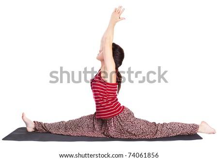 full-length portrait of beautiful woman doing the yoga splits hanumanasana (monkey pose) on fitness mat - stock photo
