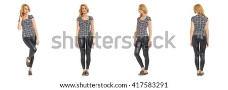 Full length portrait of beautiful woman in leather pants isolated - stock photo