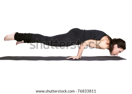 full-length portrait of beautiful woman working out yoga excercise balancing on hands on fitness mat - stock photo