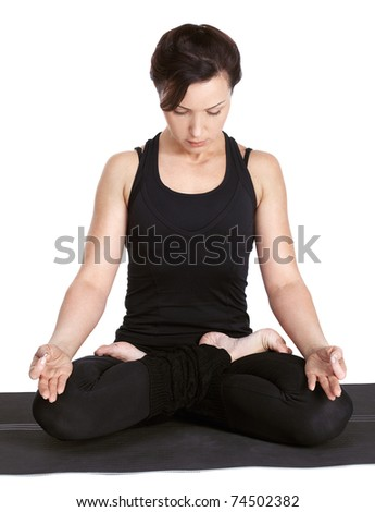 full-length portrait of beautiful woman working out yoga excercise padmasana (lotus pose) on fitness mat - stock photo