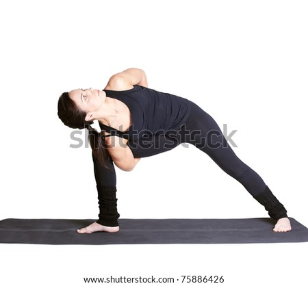 full-length portrait of beautiful woman working out yoga excercise side angle pose on fitness mat - stock photo