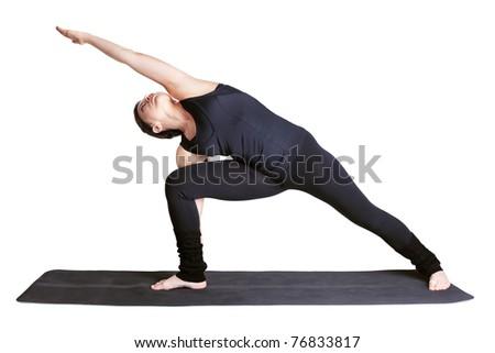 full-length portrait of beautiful woman working out yoga excercise side angle pose utthita parshvakonasana on fitness mat - stock photo