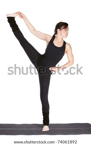 full-length portrait of beautiful woman working out yoga excercise utthita hasta padangustasana (extended hand-to-vig-toe pose). balancing on one leg on fitness mat - stock photo
