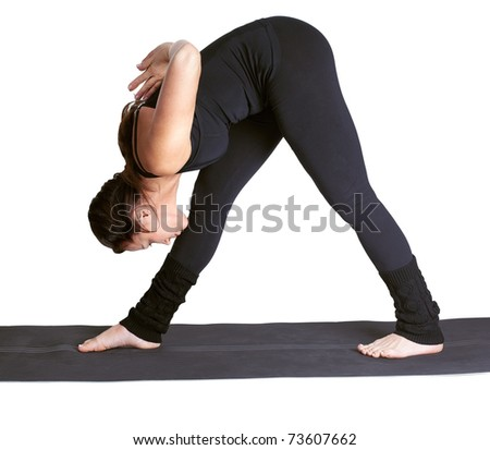 full-length portrait of beautiful woman working out yoga parshvottanasana excercises on fitness mat - stock photo