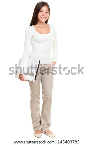 Full length portrait of beautiful young woman holding laptop isolated over white background - stock photo