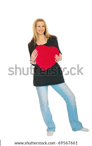 full length portrait of beautiful young woman holding red heart on white background