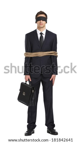 Full-length portrait of blind-folded businessman tied with the line, isolated on white. Concept of slavery and violence - stock photo