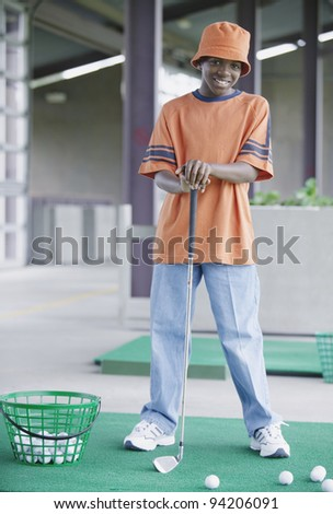 Full length portrait of boy golfing