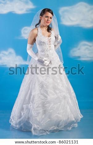 Full-length portrait of bride dressed in elegance white wedding dress - stock photo
