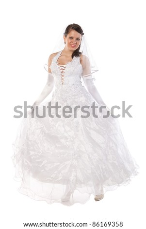 Full-length portrait of bride dressed in elegance white wedding dress, isolated on white - stock photo