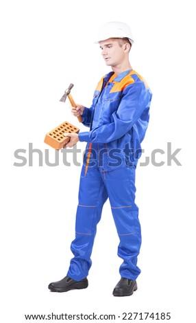 Full length Portrait of Builder in blue uniform  - stock photo