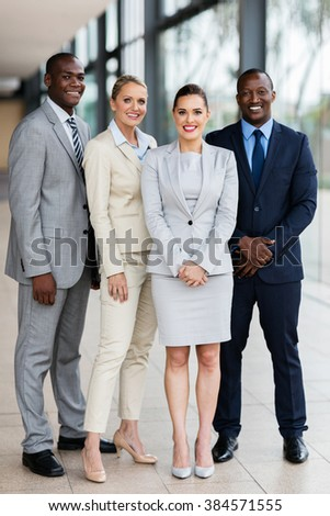 full length portrait of business group in office - stock photo