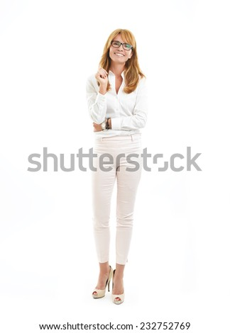 Full length portrait of business woman standing against white background. - stock photo