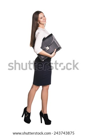 Full length portrait of business woman with briefcase  - stock photo