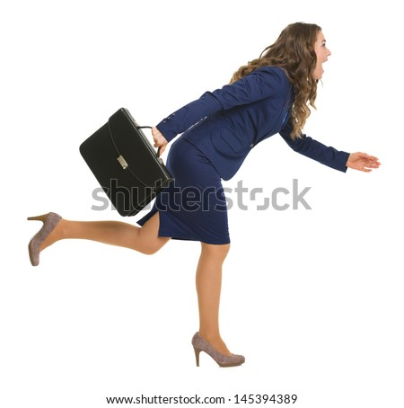 Full length portrait of business woman with briefcase running sideways - stock photo