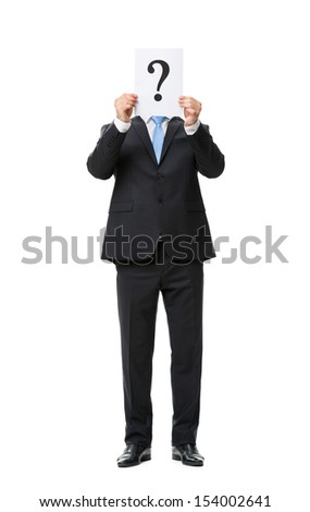 Full-length portrait of businessman keeping question mark in front of his face, isolated on white. Concept of leadership and success - stock photo