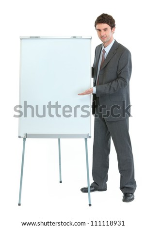 Full length portrait of businessman near flipchart stand