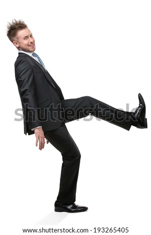 Full-length portrait of businessman shoving something who wears suit with blue tie, isolated on white - stock photo