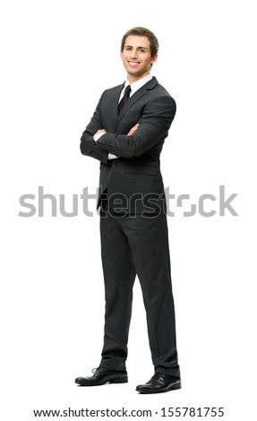 Full-length portrait of businessman with hands crossed, isolated. Concept of leadership and success - stock photo
