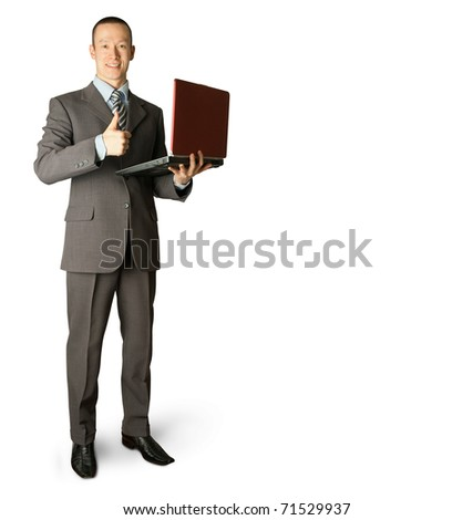 Full length portrait of businessman with laptop, showing well done