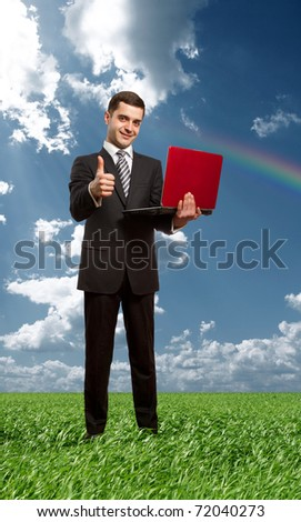 Full length portrait of businessman with laptop, showing welldone outdoors - stock photo