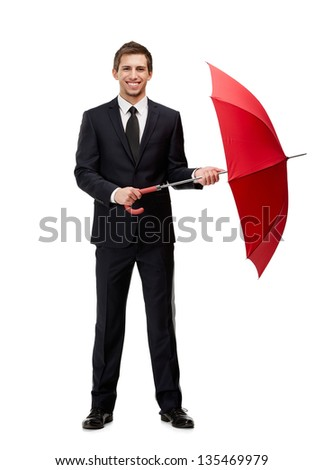 Full length portrait of businessman with opened red umbrella, isolated on white - stock photo