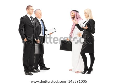 Full length portrait of businessmen and businesswoman having a conversation during a investment meeting isolated on white background - stock photo