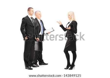 Full length portrait of businessmen and businesswoman having a conversation isolated on white background - stock photo